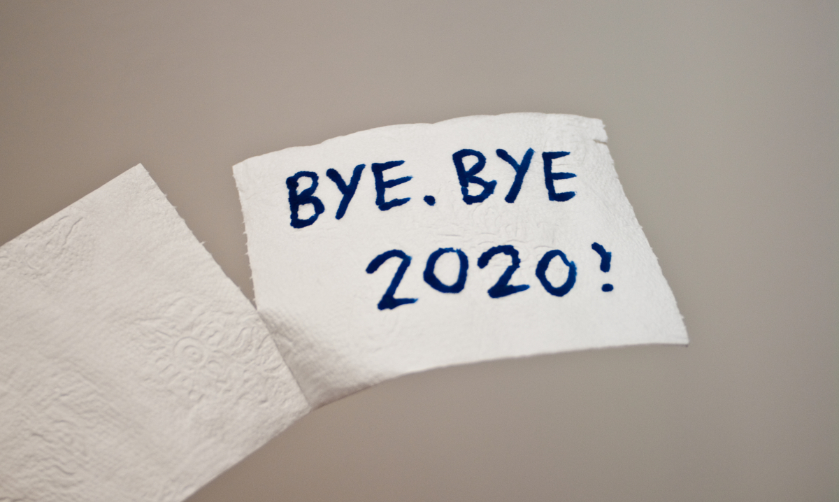 A piece of toliet paper with 'BYE. BYE. 2020!' written on it