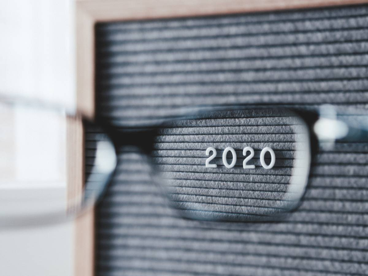 The number '2020' seen through glasses