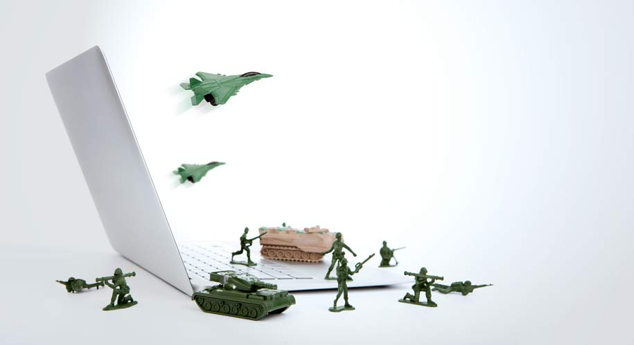 Small army figures on laptop.