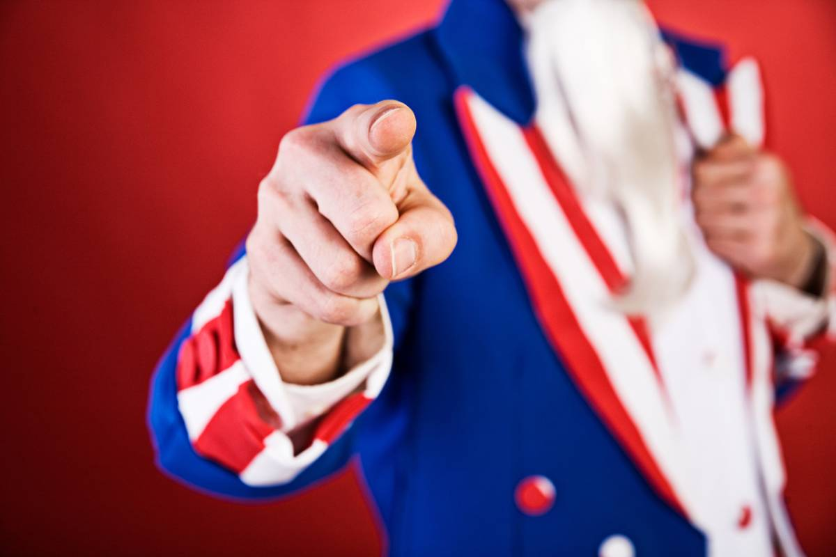 A man dressed like Uncle Sam pointing